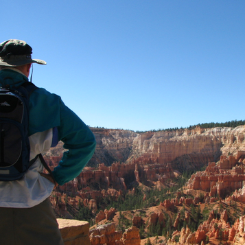 Checking out the surreal view at Bryce Canyon National Park. Learn more about visiting Bryce, Arches & Zion on the blog.