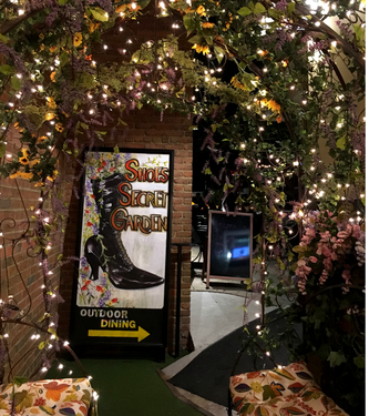 Slip down the alley into the Secret Garden next to Shoe's Cup & Cork in historic Leesburg, Virginia.